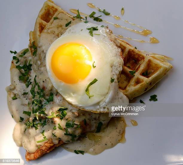 From the breakfast at night part of the menu the southern fried chicken and waffles with sausage gravy and a fried egg on top during a visit to the...
