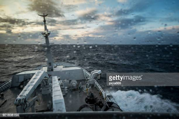 from the bridge of a fishing boat in a stormy sea - rough stock pictures, royalty-free photos & images