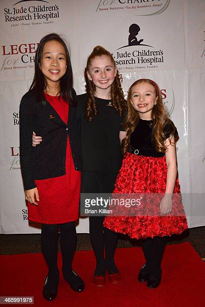 From the Broadway play Annie actresses Junah Jang Gaby Bradbury and Emily Rosenfeld attend the 2014 Legends For Charity Dinner at Grand Hyatt New...