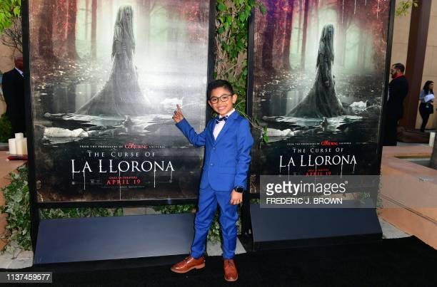 From the cast actor Jayden Valdivia points to his body on the movie poster as he arrives for the premiere of The Curse of La Llorona at the Egyptian...