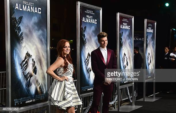 From the cast actress Michelle DeFraites and guest pose on arrival for the Los Angeles Premiere of Project Almanac on January 27 2015 in Hollywood...