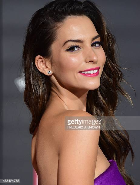 From the cast Genesis Rodriguez who plays Honey Lemon poses on arrival for the premiere of Disney's 'Big Hero 6' in Hollywood California on November...