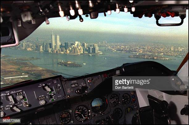 From the cockpit of a 747 jumbo jet flying at 1500–ft the twin World Trade Center towers loom distinctly on the Manhattan skyline The Nov 1994 view...