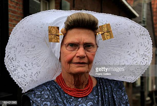 From the costume you could read, , that she is protestant ,from Zuid-Beveland, near the town of Goes.
