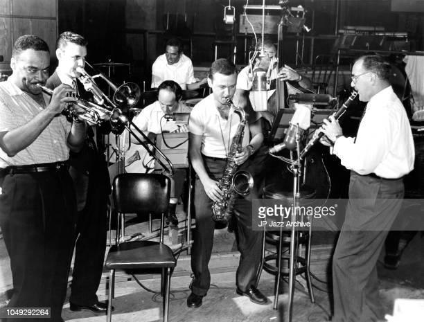 From the film 'The Benny Goodman Story' 1956 From left to right Buck Clayton Urbie Green Gene Krupa Allan Reuss Stan Getz George Duvivier Benny...