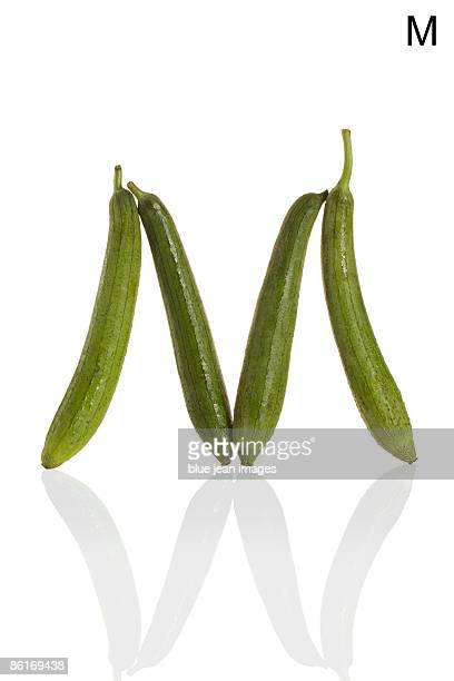 from the health-abet, the letter m, gourds. - loofah stock photos and pictures