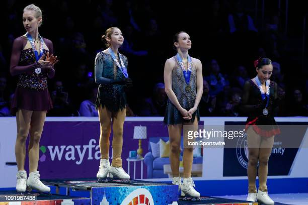 From the left Bradie Tennell Alysa Liu Mariah Bell and Hanna Harrell pose for photographs during the awards ceremony following the ladies free skate...