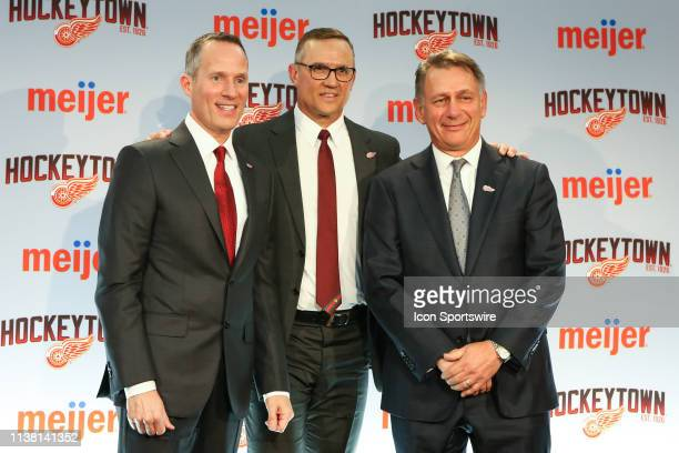 From the left Detroit Red Wings Governor President and CEO Christopher Illitch Steve Yzerman and Ken Holland pose for photographs during a press...