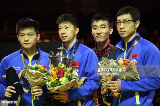 From the left Fan Zhendong of China Ma Long of China Lee Sangsu of Korea republic and Xu Xin of China for the memorial photograph during the Table...