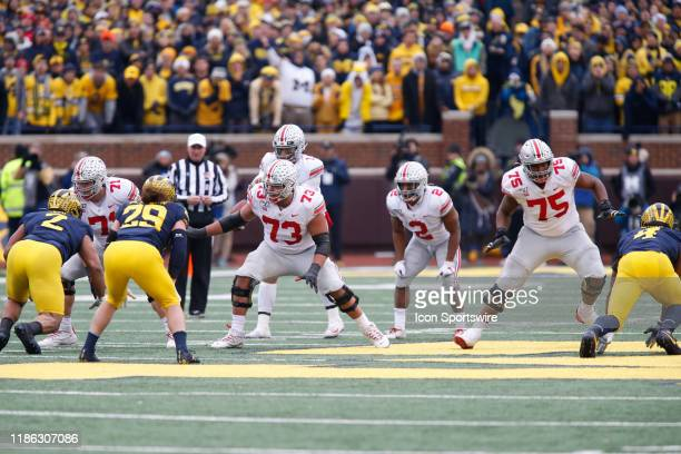 From the left Ohio State Buckeyes offensive lineman Josh Myers Ohio State Buckeyes offensive lineman Jonah Jackson and Ohio State Buckeyes offensive...