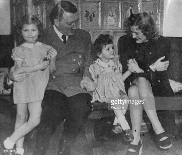From the photograph album of Eva Braun discovered in Frankfurt a picture of her relaxing with her husband German fascist dictator Adolf Hitler and...
