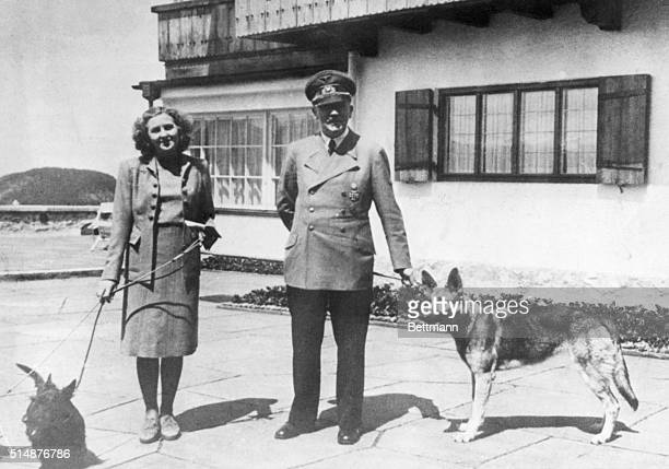 From the photograph album owned by Eva Braun Hitler's supposed wife recently discovered by Americans at Frankfurt Hitler and Eva Braun with their...