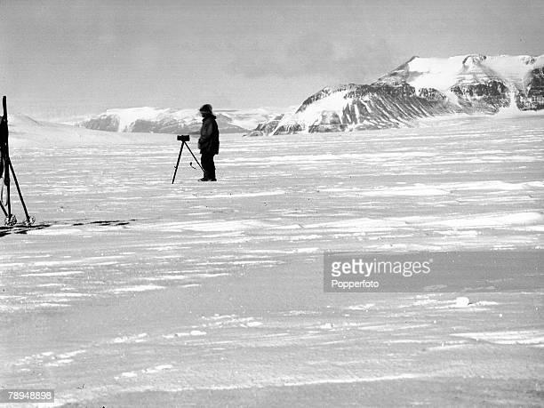 From the Ponting Collection Captain Robert Falcon Scott Photographer Scotts Antarctic Expedition 1910 1912 Photographer Herbert Ponting taking...