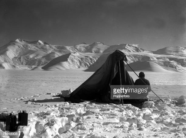 From the Ponting Collection Captain Robert Falcon Scott Photographer Scotts Antarctic Expedition 1910 1912 Dr Wilson sitting outside his tent making...