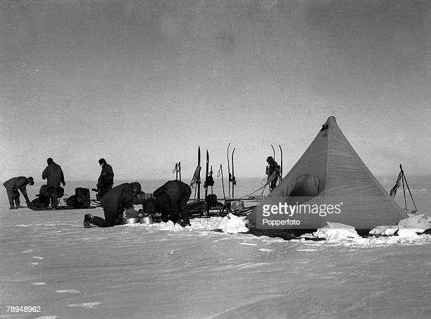 From the Ponting Collection Lieutenant Henry Bowers Photographer Scotts Antarctic Expedition 1910 1912 Expedition team members pitching a tent as...