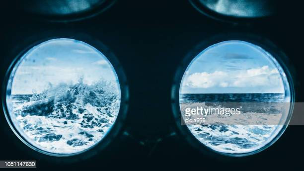 from the porthole window of a vessel in rough sea - passenger craft stock pictures, royalty-free photos & images