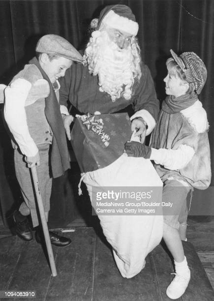 Kerry Cavanaugh left as Tiny Tim and Kathryn Cavanaugh talk with Santa Arnold Turner The three star in the Dickens Repertory Theatre Company's...
