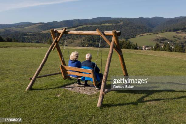 From the viewpoint of the hillside chairlift a grass meadow landscape Polish visitors look down on the Polish village of Jaworki on 21st September...