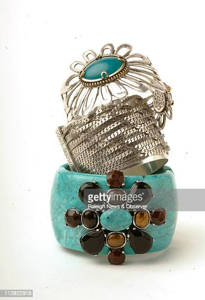 From top Erica Lyons turquoise bracelet with multi stones Jessica Simpson silver chain cuff and Lucky Brand flower cuff with turquoise stones from...