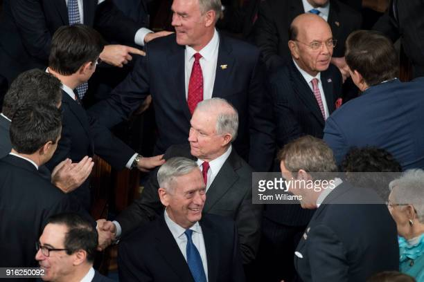 From top Interior Secretary Ryan Zinke Attorney General Jeff Sessions and Defense Secretary James Mattis arrive in the House chamber for President...