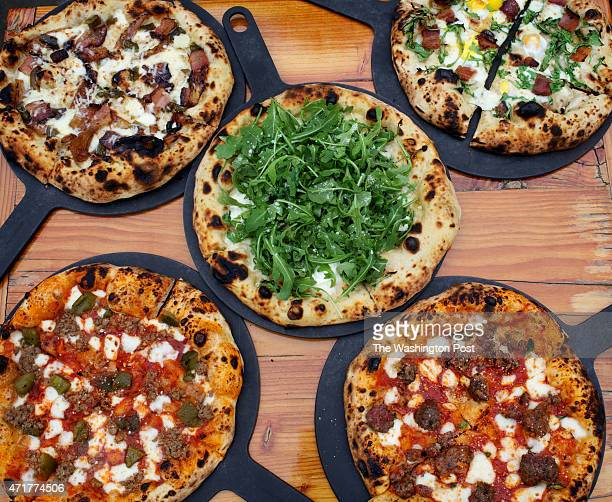 From top left clockwise the Hot Mess the Bacon Egg the Meatball Sausage Peppers and the Arugula pie from FranklyPizza photographed in Kensington MD
