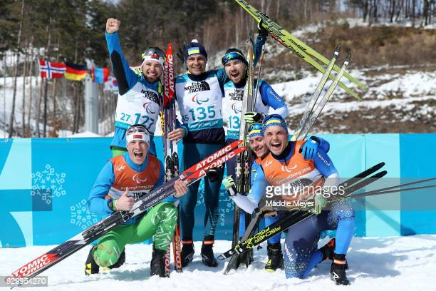 From top left silver medalist Yury Holub of Belarus gold medalist Vitaliy Luk'yanenko of Ukraine bronze medalist Anatolii Kovalevskyi of Ukraine and...