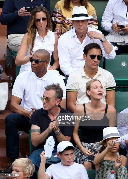 From top Marion Cotillard Guillaume Canet Anna Eberstein Hugh Grant Clive Owen Tim Roth and his wife Nikki Butler during the men's final on Day 15 of...