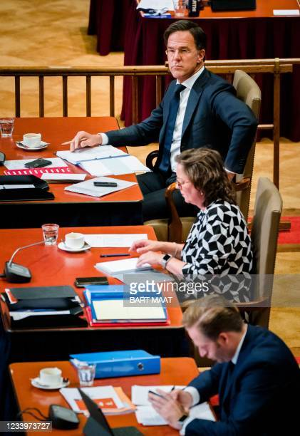 Outgoing Prime Minister Mark Rutte, outgoing Minister Tamara van Ark for Medical Care and outgoing Minister Hugo de Jonge of Health, Welfare and...