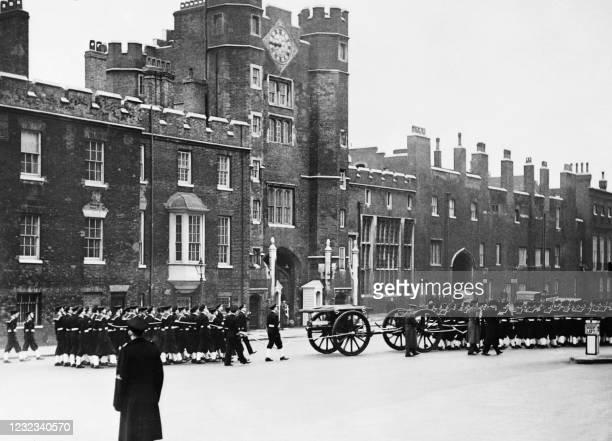 From Westminter Hall to St.James's Palace the slow procession at funeral pace has taken three quarters of an hour. Here naval Ratings are seen...