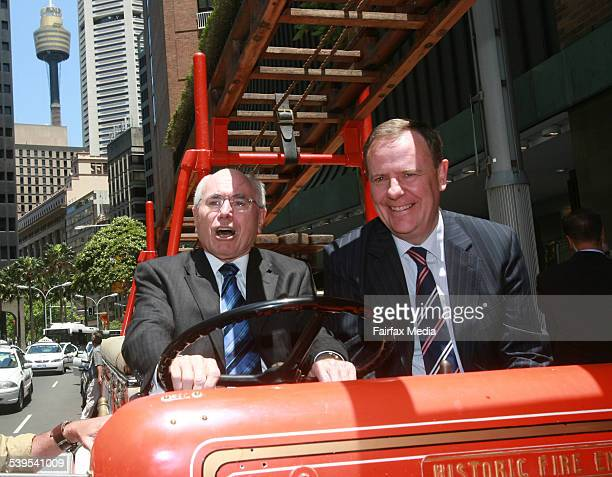 Fromer Prime Minister John Howard and Treasurer Peter Costello sit in the Daily Telegraph's old fire engine before going to the 'Go for Growtyh'...