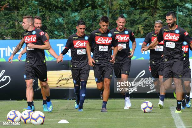 Fromn L to R Napoli's Croatian midfielder Marko Rog Napoli's Italian defender Lorenzo Tonelli Napoli's Spanish striker Jose Maria Callejon Napoli's...