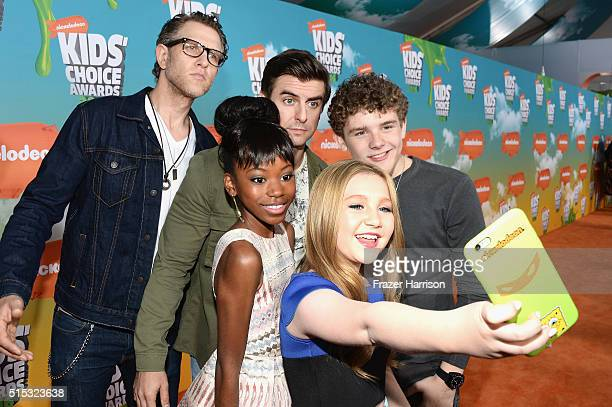 Front actresses Riele Downs Ella Anderson back Jeffery Brown Cooper Barnes and Sean Ryan Fox of Henry Danger take a selfie at the Nickelodeon's 2016...