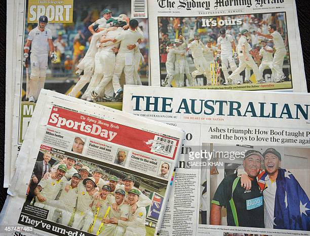 Front and back pages of the Australian newspapers display victory celebrations by the Australia cricket team after winning the Ashes Test series...