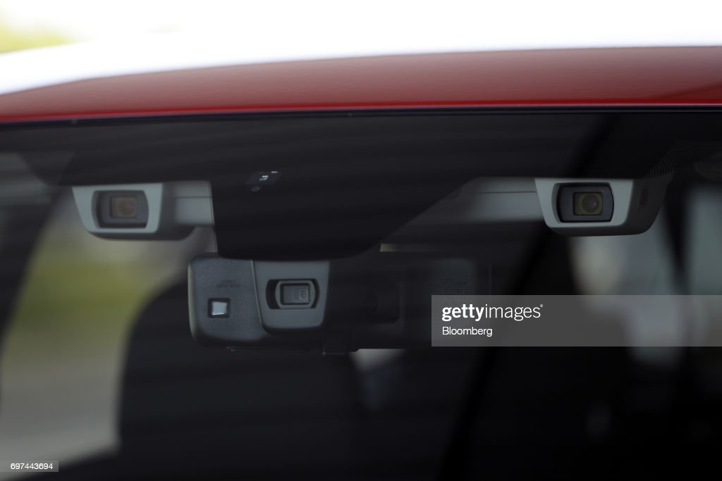 Front cameras, top, are mounted by the rearview mirror on a prototype Subaru Corp. Levorg vehicle equipped with the company's EyeSight driving support system during a test drive at Japan Automobile Research Institute's (JARI) Shirosato Test Center in Shirosato, Ibaraki, Japan, on Thursday, June 15, 2017. The EyeSight technology warns drivers when there is potential danger and can apply brakes. Photographer: Kiyoshi Ota/Bloomberg via Getty Images