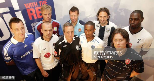 Front Chelsea captain John Terry Fulham captain Danny Murphy referee Alan Wiley Portsmouth player Jermaine Defoe and Arsenal's Tomas Rosicky Back...
