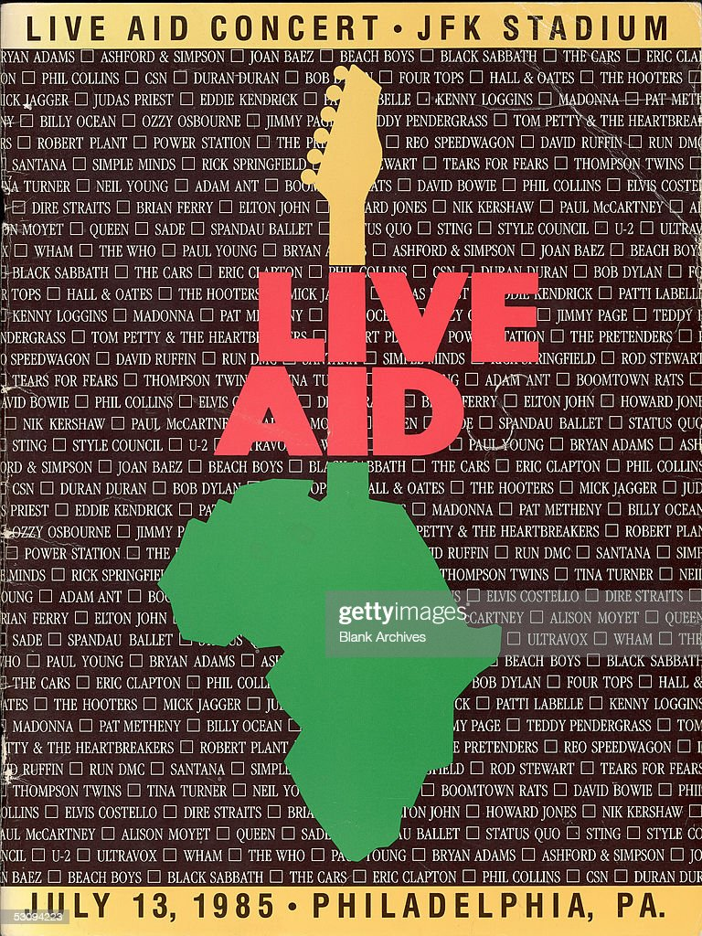 Front cover of the program from the Live Aid concert at JFK Stadium in Philadelphia, Pennsylvania, July 13, 1985. The concert, and a simultaneous one at Wembley Stadium in London, England, were designed to raise awareness and funds for a worldwide hunger relief program. The cover features an outline of Africa with the neck of a guitar overlaid on a list of the scheduled performers.
