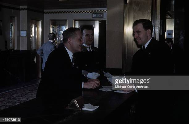 A front desk clerk helps a guest with his mail at the front desk in The Plaza Hotel in New York New York