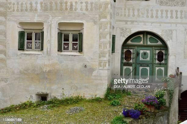 Front door and windows of a house, Guarda, Scuol, Engadin, Canton of Graubunden, Switzerland.