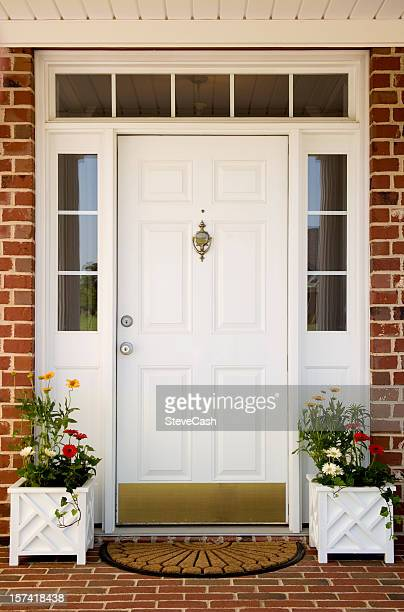 front door of home - door knocker stock photos and pictures