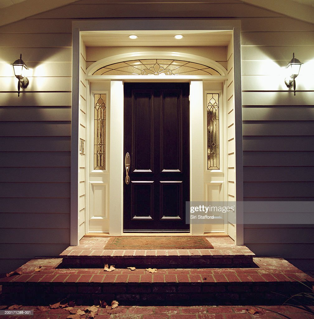 Front door of house with lights at night & Front Door Stock Photos and Pictures | Getty Images