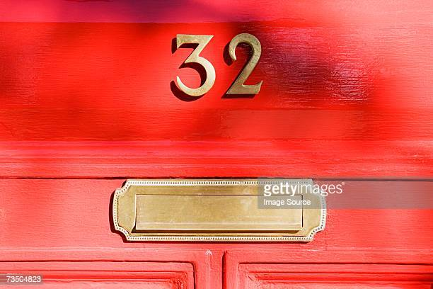 front door - numbers stock photos and pictures