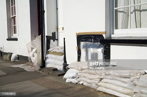 Front doors with sandbags for flood control