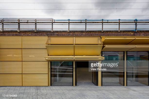 Front elevation of arch with railroad tracks on top. Morning Lane Arches, London, United Kingdom. Architect: Adjaye Associates , 2016..