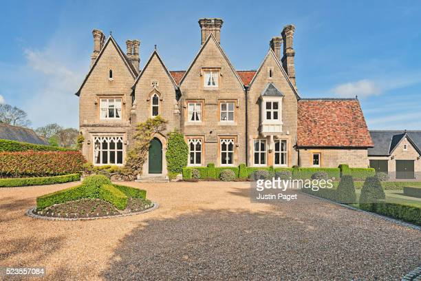 front elevation of english country home - grounds stock pictures, royalty-free photos & images