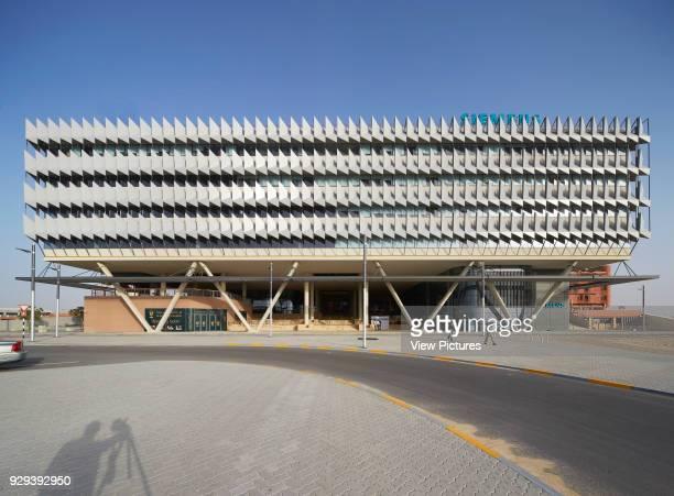 Front elevation of headquarters from approach. Siemens Masdar, Abu Dhabi, United Arab Emirates. Architect: Sheppard Robson, 2014.