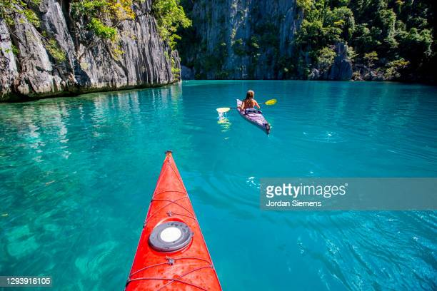 front end of a red kayak in the philippines. - capital region stock pictures, royalty-free photos & images