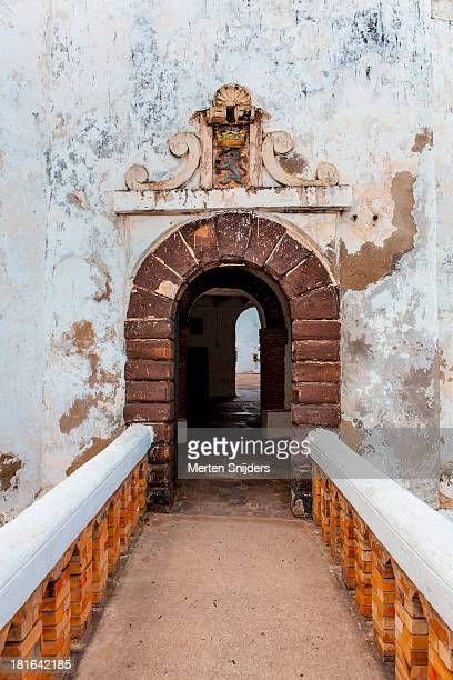 front entrance bridge to elmina castle - ghana stock pictures, royalty-free photos & images