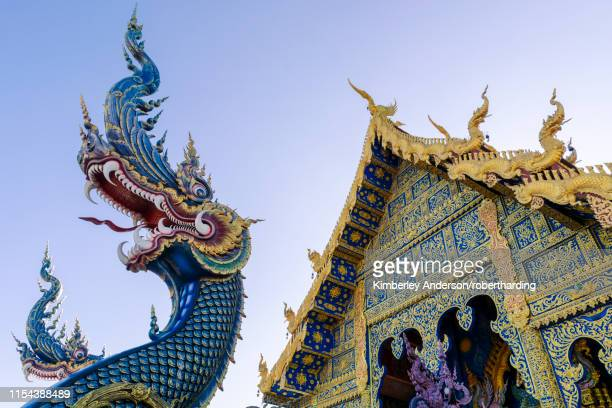 front entrance of wat rong suea ten (blue temple) in chiang rai, thailand, southeast asia, asia - wat stock pictures, royalty-free photos & images