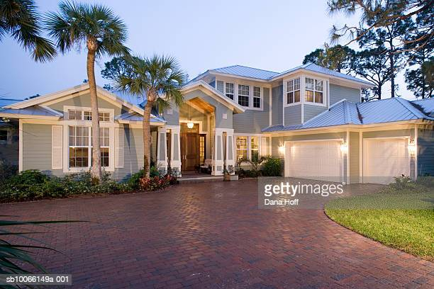 front exterior of modern house at sunset - paving stone stock pictures, royalty-free photos & images
