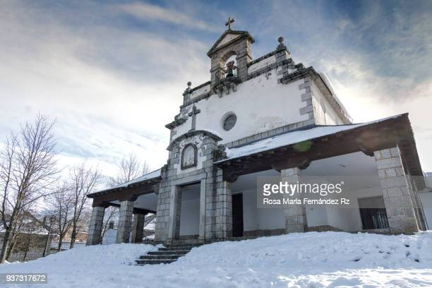 Front facade Nuestra Sra. del Rosario Church after a day of snowfall, Valsain, San Ildefonso, Segovia, Spain, Europe.